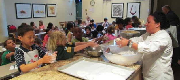 Lisa Falso shows students how to shape dough for sweet fry-bread.