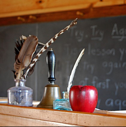 quill pen and apple